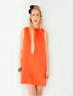 The fun color of this dress and the short mini cut length makes this piece perfect for every fashion lover.