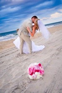 Another great beach wedding shot.    i love that type of kiss it's so romantic and being the way the sky and sands colors are... it's breathtaking