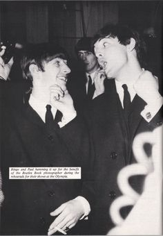 Ringo Starr & Paul McCartney hamming it up for the benefit of the Beatles Book photographer during rehearsals for their shows at the Olympia, in Paris c.
