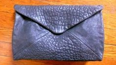 DIY leather purse? WOW.  And only handstiching.  Awesome.