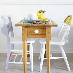 Small dining room with slimline table and painted chairs