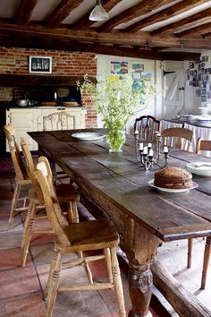 LOVE BEAMS, FLOOR, LARGE TABLE ....  Beautiful Rustic Cottage Kitchen with Farmhouse Table and Stove