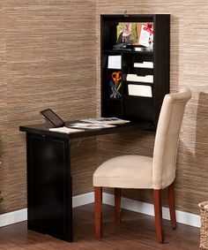 Make the most of a small space with this innovative desk. This charming piece folds out from the wall for more work space and can just as easily be packed away when not in use. Designed with two adjustable shelves, it offers a little extra storage as well.Closed: 22'' W x 32'' H x 6'' DOpen: 30'' W x 28.75'' H x 20'' DB...