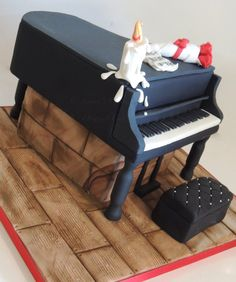 Piano cake. Love it! Especially the dripping candle...I've had that happen at a recital, and had to scrape the piano clean with credit cards!