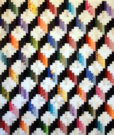 T-Color Cubes by Linda Rotz Miller. This appears to be made from the Tumbling Logs pattern in Judy Martin's Log Cabin Quilt Book. Lovely work!