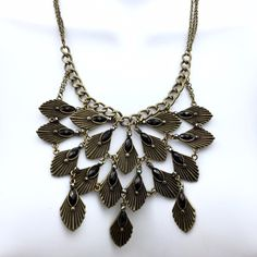 Falling Leaves down my neck Necklace Beautiful statement with a romantic and warrior touch. Wear on a bare neck a shoulder over a strapless maxi dress with thigh high slit opening. Add long earrings and strong bold black bracelets. Hello Boho. Unnamed Opulence Jewelry Necklaces