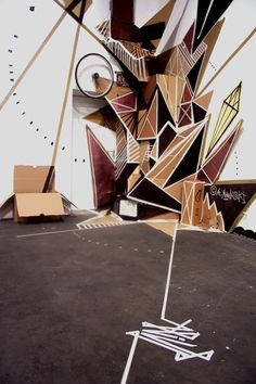 'Alive' is an installation at the Pottporus Festival in Herne (2007) made of boxes, tape, spray, and a television by Clemens Behr.