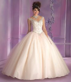 Turn heads wearing this beautiful Mori Lee Vizcaya Quinceanera Dress Style 89006 at your Sweet 15 party. Made out of layered tulle, this ball gown features a sleeveless bodice with lovely beaded embro