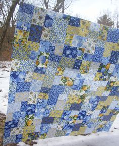 """Summer breeze fabrics by Moda, quilted with a wavy line to represent the """"breeze"""".  My first free-motion quilting project.  I used the double slice layer cake method for cutting and sewing."""