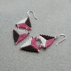 Triangle earrings.  I changed this one slightly and also made a matching necklace.  I called it Good and Plenty, like the pink, white, and black candies.