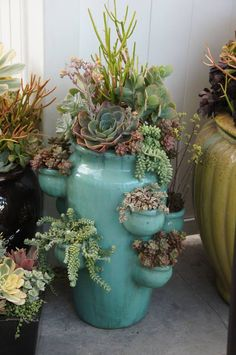 #pots #pottery #planters #containers Paint, varnish, add succulents to your strawberry pots....bring inside during the winter for instant color & life! Love this idea ♥