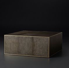 RH Modern's Smythson Shagreen Cube Square Coffee Table:A 1970s interpretation of French Art Deco design, our table from designer Anthony Cox celebrates the marriage of two eras. With elegant materials and a refined form, it's clad in rich shagreen-embossed leather with metal trim detail.