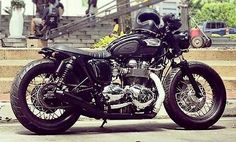 Hinckley Triumph Bonneville custom with lowered suspension, black rims and low-profile seat