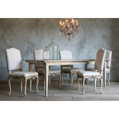 """Antique Reproduction Provence Dining Chairs, in Butter Cream finish with antique gilt accents. Upholstered in Fog Linen with brass tacks. Gorgeous chairs for your dining table! Seat height is 19""""."""