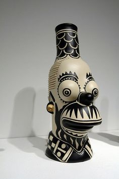 'Homer Clobbered by Chongo' (2009) by New Mexico-based Cochiti Pueblo ceramic artist Diego Romero (b.1964). Ceramic, paint, found objects. via sofaexpo on Flickr