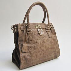 """Pamper yourself with the """"Natalie Satchel in Pecan"""". You'll look so sophisticated and chic. #mimiboutique #accessories"""