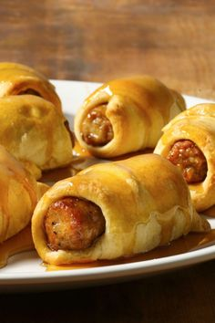 Crescent Dogs with sausage and sweet maple syrup are great for breakfast or dinner! #breakfast #brunch #recipe #food #recipes