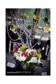 manzanita branch centerpiece with strung crystals, hydrangea and floral  by Love Is In The Air.  www.loveisintheairevents.com