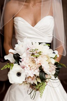 Each bridesmaid bouquet was a all white of a particular flower. Then the bride took one of each of their flowers to make her bouquet. Love the black leaves and anemones. Anemone Bouquet, Pastel Bouquet, Black Bouquet, Anemones, Bouquet Flowers, Floral Wedding, Wedding Bouquets, Wedding Dresses, Wedding Flowers