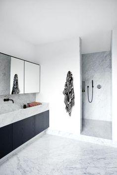 Minimal Marble Bathroom with Black Cabinets