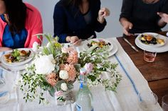 Love this simple tea towel and fresh flowers table setting