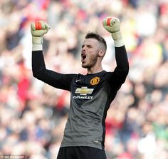 David de Gea raises his hands in joy after the final whistle in the win his immense saves ...