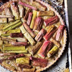 Spring rhubarb is wonderfully pink and tender, so you can dispense with the poaching step and put it straight into a pastry case (shell) with a little brown sugar before putting it in the oven.