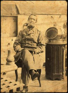 "Confederate Capt. Raphael Semmes on the CSS Alabama.  ""The image shows Captain Semmes seated next to the binnacle,  which contained the compass.""  From a photograph, taken at Cape Town, South Africa, August 19, 1863."