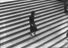 Martin Munkácsi | Woman walking down stairs, 1936