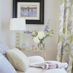 White room with sofa, picture and floral curtains  #floral #curtain #cushion #pillow