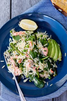 Spring Salmon, Asparagus and Risoni Salad - poached salmon is tossed with risoni, grilled asparagus, spinach and peas, dressed with lemon, olive oil and parsley, and served with chunks of creamy avocado.