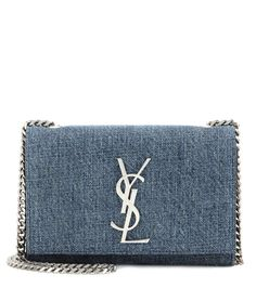 Saint Laurent - Classic Monogram denim shoulder bag - The 'Classic Monogram' bag is crafted from a blue denim, giving the silver-tone logo centre stage. - @ www.mytheresa.com