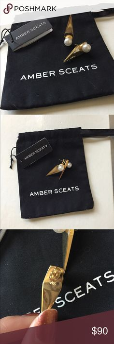 • nwt amber sceats prism earrings • Set of brand new amber sceats earrings. (The same designer who made the famous face shaped earrings.) A faux pearl rests inside a beautiful golden, geometric, coffin shaped backing. Has AS engraved on back. Very nice weight to them; they feel and look expensive. These are called the prism earrings.   Stainless steel setting. 18k gold plate. Comes with dust bag. No flaws. Topshop Jewelry Earrings