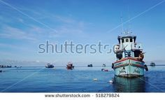 12 NOV 2016 Surat Thani , Thailand  various color of fishing boat on ocean with blue water and skyline in morning