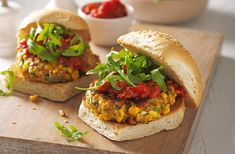 This must-eat recipe of spiced chickpea & sweetcorn patties with smoky tomato sauce is quick & simple. Discover more vegetarian recipes at Tesco Real Food. NOT gluten free, but would be easily adapted. Gluten Free Vegetarian Recipes, Veggie Recipes, Burger Recipes, Veggie Bbq, Vegetarian Food, Healthy Food, Savoury Recipes, Dinner Healthy, Veggie Dishes