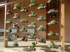 Urban Garden Design Plastic bottles used in vertical garden; Simple and awesome! More - Great for the gardener who wants to save space, vertical gardens serve many purposes. Vertical Garden Diy, Vertical Gardens, Vertical Planting, Vertical Farming, Small Gardens, Bottle Garden, Bottle Plant, Pet Bottle, Bottle Wall