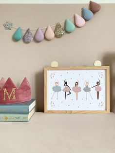 Ballerina, ballet wall art posters. Huge range of affordable + high quality wall art prints. Posters and printables for adult spaces, children's bedrooms, nursery and playrooms. Personalised initials. Typography and inspirational quotes to suit any decor or interior style. Soft pink toddler girls bedroom with wooden star wall hooks.