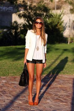 Seams for a desire. White blazer, leather shorts and burnt orange heels