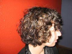 Curly bob by East 42nd Street Salon