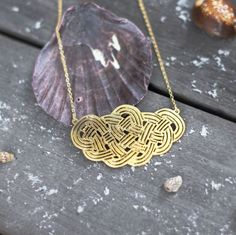 Yacht necklace by Shlomit Ofir.  Available at www.pinwheeljewels.com