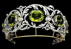 Peridot tiara of Austrian Archduchess Isabelle. There are 5 peridot stones in the tiara, each surrounded by a scrolling foliate diamond frame. The tiara is part of a parure which includes a set of earrings, a large brooch (or 'devant de corsage') & a necklace. The necklace includes seven drops which can be removed and mounted upright on the tiara. The tiara dates from the 1820s and is attributed to Kochert, court jeweler to the sprawling Habsburg family in Austria. #PeridotTiara…