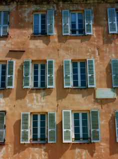 Corsica, France---I wonder if we could do a faux finish on some fabric for the front of the a frame and then make some fake shutters?