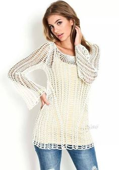 Lovely crochet top. I like the interesting ways the grid of stitches is changed up. ~CAWeStruck