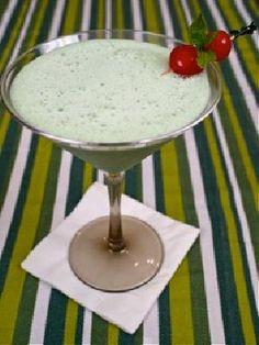 The Naughty Leprechaun   (2 cups vanilla ice cream  1/4 cup Bailey's Original Irish Cream  1/4 cup Creme de Menthe  1/2 cup milk  Garnish:  Mint sprigs  Red or green maraschino cherries)