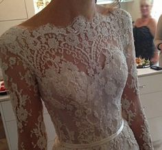 the most beautiful lace bodice wedding dress | scalloped french alencon lace with pearl embellishment | sweetheart corseted neckline with lace overlay long sleeves