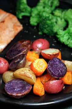 Simple and delish. Purple and Orange rule!!!!   Colorful Roasted Potatoes with Carrots and Rosemary