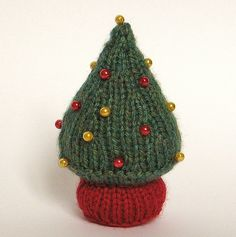 CHRISTMAS TREE KNITTING PATTERNS  Use these little trees to decorate your home for the festive season. Knit a few to sit on bookshelves or your mantelpiece, or hang them from your tree. They don't use much yarn and can be made in about an hour.  TECHNIQUES:  All pieces are knitted flat (back and forth) on a pair of straight knitting needles. You will need to cast on, knit, work a k2tog decrease, a kfb increase and sew seams.   FINISHED SIZE: The tree is 10cm high.