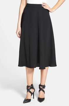 Free shipping and returns on Soprano Midi Skirt (Juniors) at Nordstrom.com. A lightly pleated midi skirt with vintage-chic appeal adds the perfect amount of flounce to any look.