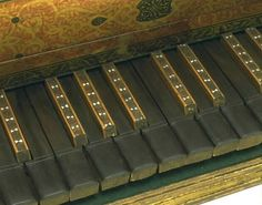 Queen Elizabeth I's Virginal, closeup of the keys.  The virginal was like a harpsichord, pressing a key caused a string to be plucked.