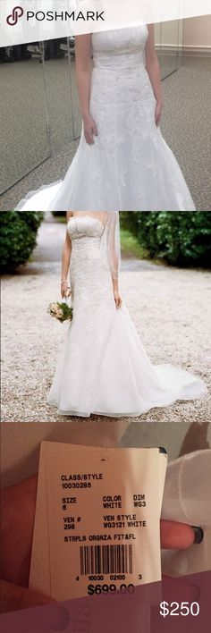 New with Tags David's Bridal Wedding Dress Fit and flare, size 6, white, organza, strapless. Never worn or altered, kept in a smoke free and pet free home. David's Bridal Dresses Wedding